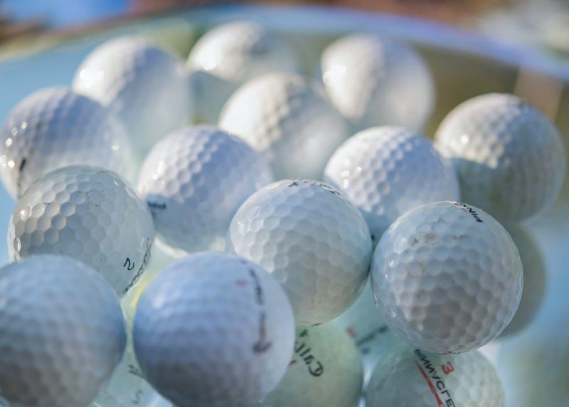 white golf ball on green golf course